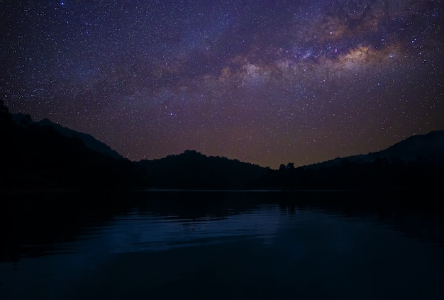Milky way across sky over reservoir at asia
