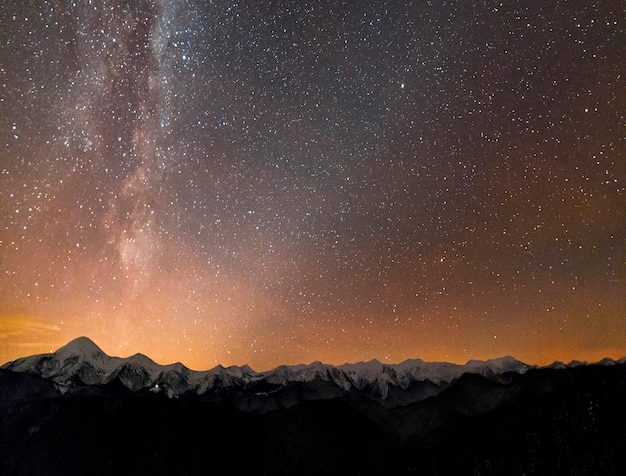Milky way bright constellation over mountains