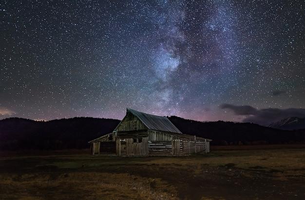 Milky way in the dark night over mormon row historic.