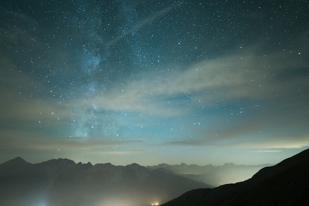 Milky way galaxy and starry sky from high elevation in summertime on the alps