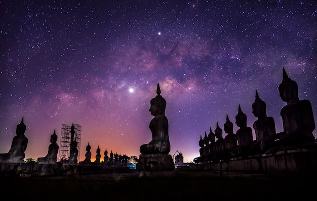 Milky way galaxy with buddha stature dark filter style
