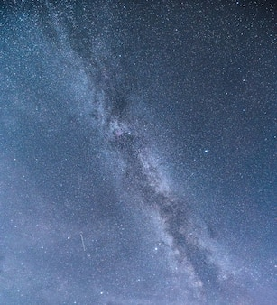 Milky way galaxy with starry and shooting star in the night sky
