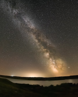 The milky way above lake diefenbaker at the sask landing in saskatchewan, canada