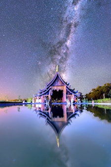 The milky way rises above the church. of temples in udon thani province