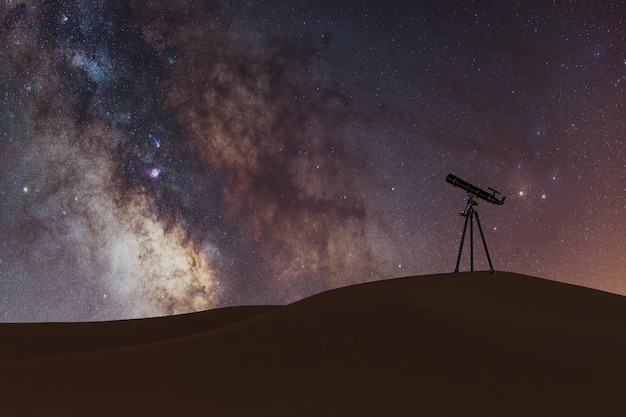 Milky way with small telescope in the desert