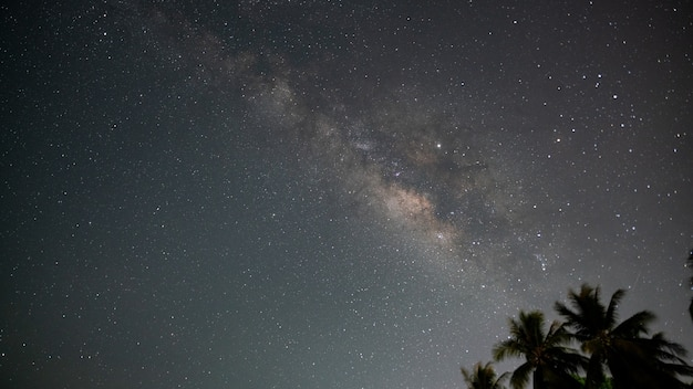 Milky way with stars shining brightly beautiful at night on the sky background in phuket thailand amazing milky way and stars in the night sky.