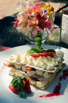 Mille-feuille on a serving table on the summer restaurant grounds
