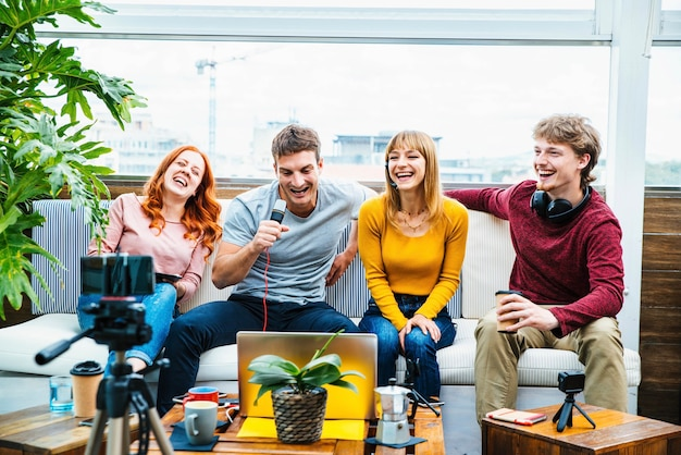 Millennial creative streamer group recording video broadcasting live on social media platforms