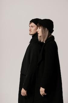 Millennial fashion couple on a white in studio
