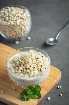 Millet coconut milk dessert in glass bowl
