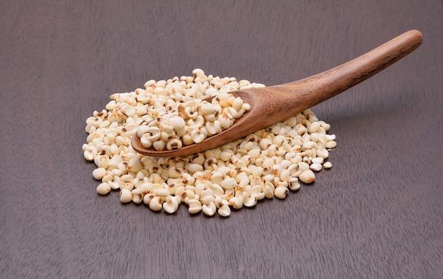 Millet grains on the wooden floor