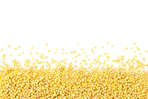Millet scattered on a white, isolated. mille