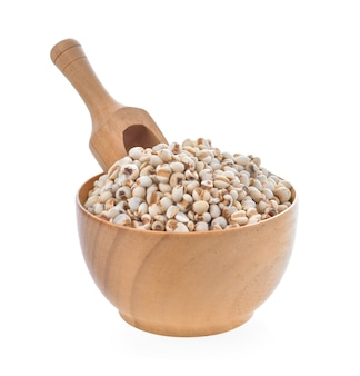 Millet in wood bowl on white background