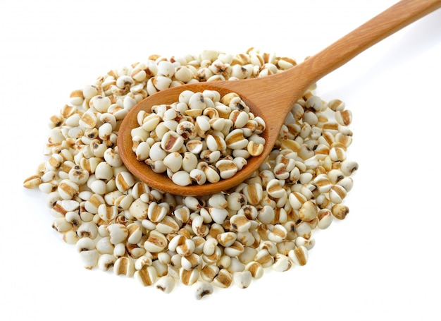 Millet in wood spoon isolated on white isolated