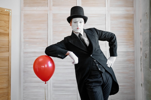 Mime artist, scene with air balloon, comedy parody