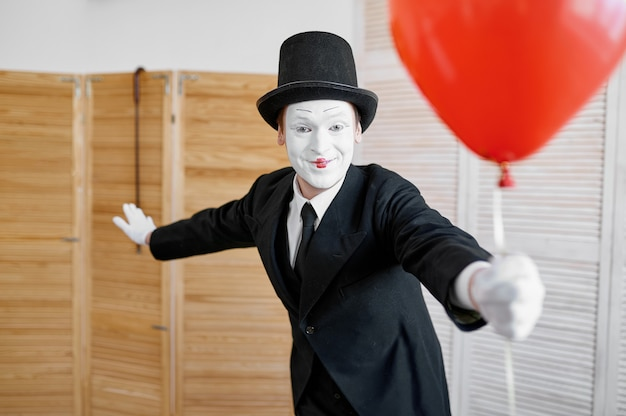 Mime artist with air balloon, comedy parody