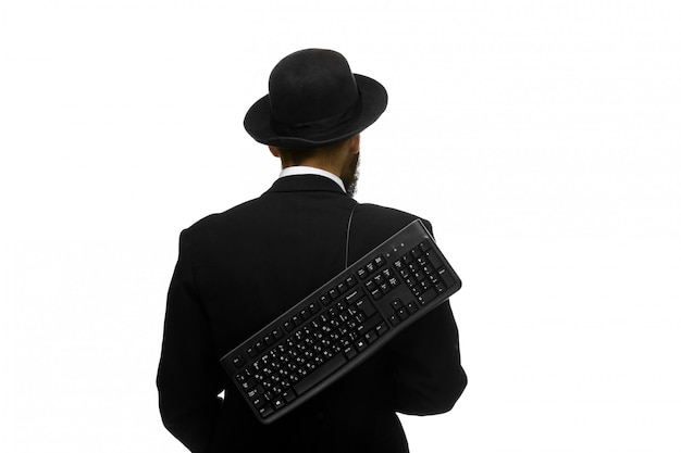 Mime as a businessman holdinga keyboard behind