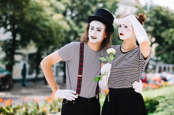Mime couple looking somewhere in park