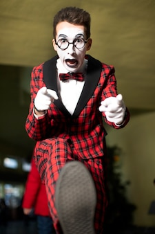 Mime guy with glasses is coming