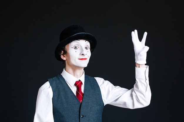 Mime shows sign of victory with his fingers