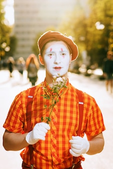 Mime on the street waiting to meet with his lover