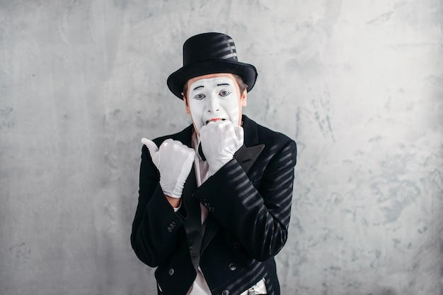 Mimic male person with white makeup mask.