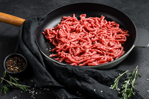 Mince. ground meat with ingredients for cooking. top view