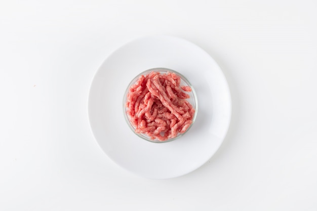 Minced meat in glass petri dish for laboratory studies chemical experiment