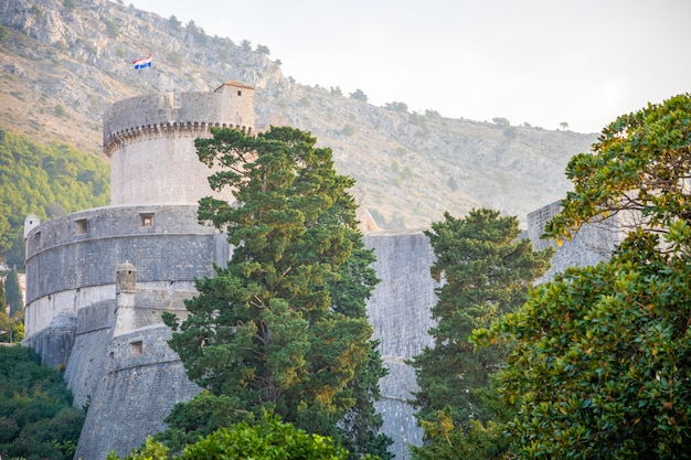 Minceta tower and dubrovnik medieval old town city walls at sunset time, croatia