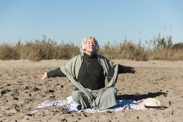 Mindfulness concept with old woman outdoors