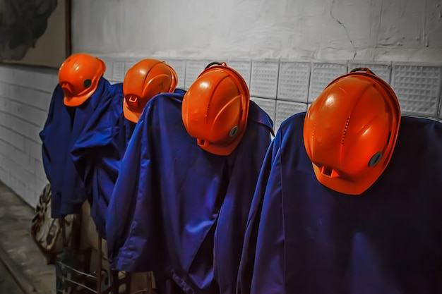 Miner's overalls with orange helmets. miner's clothing.