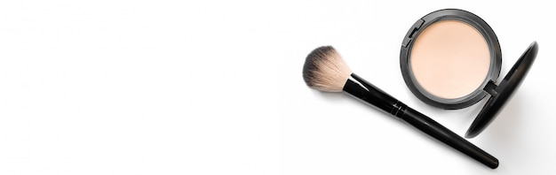Mineral compact powder with a brush for application, isolated on a white background. banner