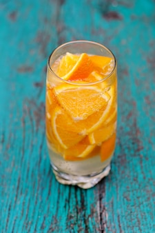 Mineral water with pieces of orange