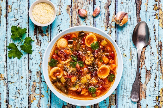 Minestrone, italian vegetable soup with pasta and beans. top view
