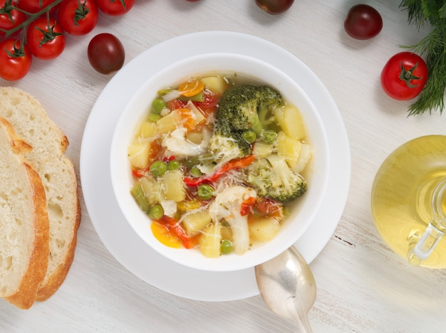 Minestrone soup. vegetable soup with tomato, celery, carrot, zucchini,  pepper, broccoli.