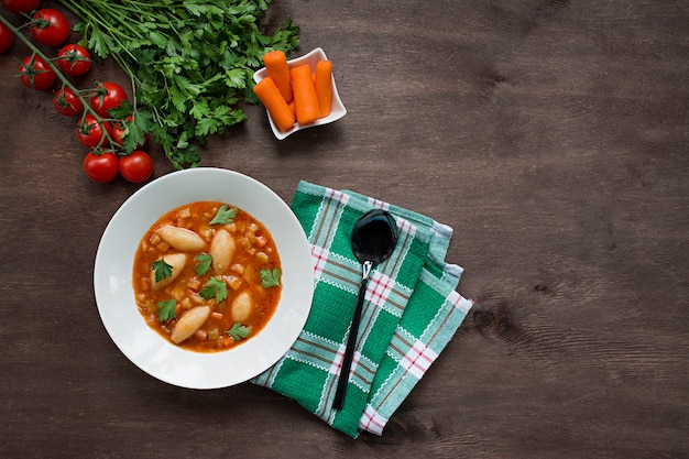 Minestrone soup with pasta and herbs. italian food.place for text.