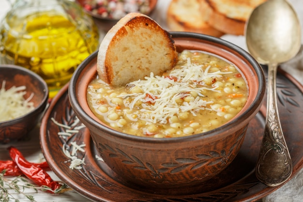 Minestrone, thick soup with vegetables , pasta, lentils, cheese and spices