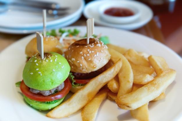 Mini burger set in white plate.