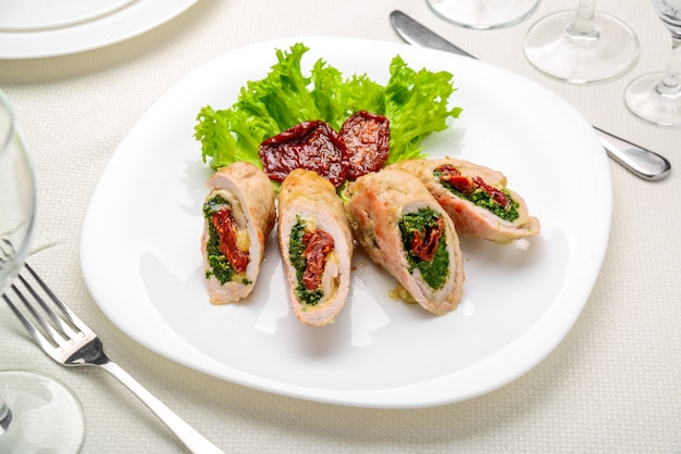 Mini chicken rolls with dried tomatoes and spinach. festive dish.