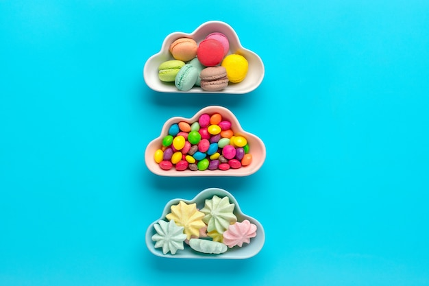 Mini colorful sweets in bowl in shape of cloud isolated