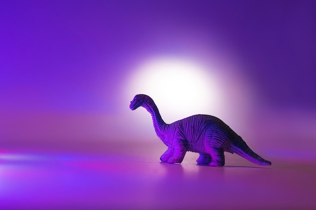 Mini dinosaurs in neon pink and blue.