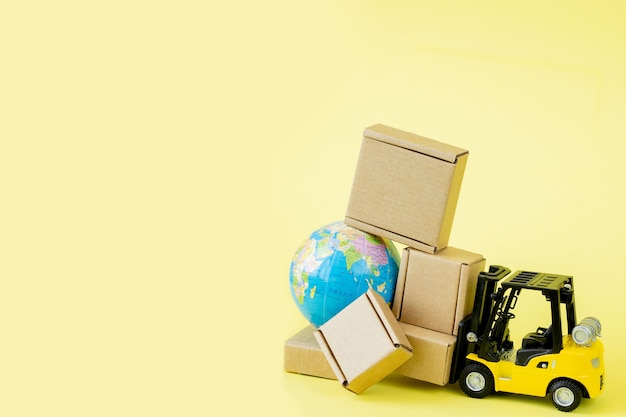 Mini forklift truck load cardboard boxes. fast delivery of goods and products.