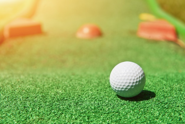 Mini-golf ball on artificial grass. summer season game