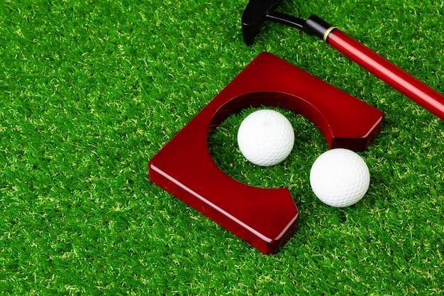 Mini golf equipment on grass close up