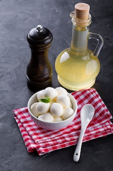 Mini mozzarella in bowl with oil