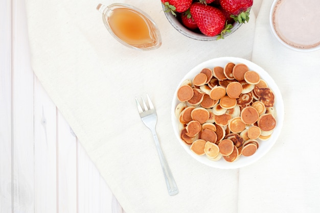 Mini pancakes in a bowl.