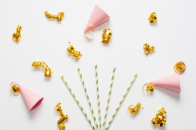 Mini party hats with golden ribbons