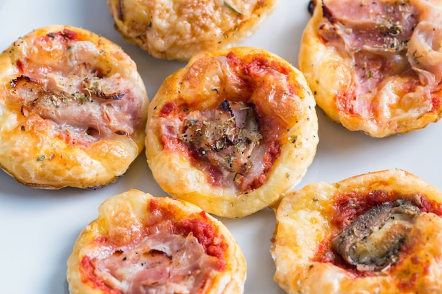 Mini pizza with puff pastry.