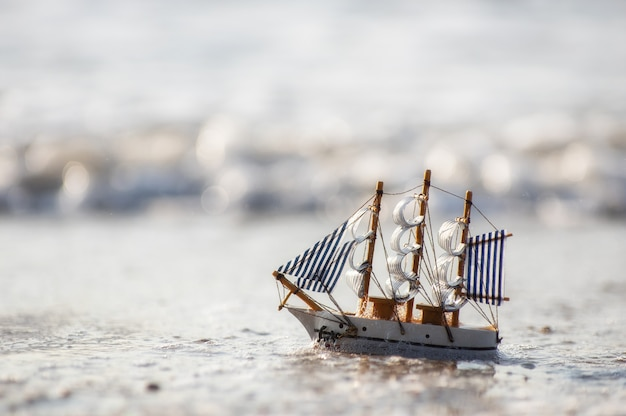 Mini sailboat on sea