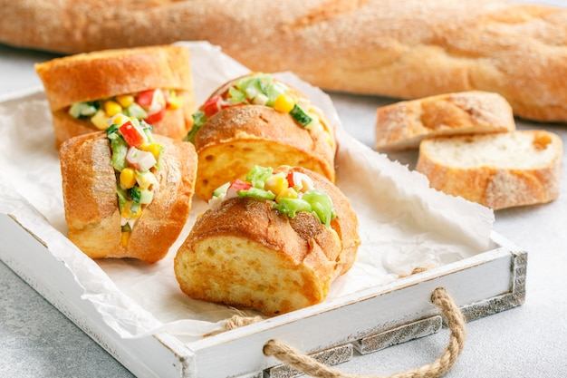 Mini sandwiches with crab salad, corn, cucumber and lettuce